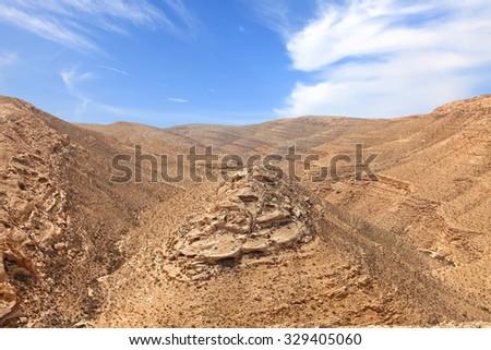 Geological erosion land form in stone desert. Magic desert landscape in the National geological park Yeruham Park in the Negev desert, Israel - stock photo