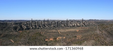 Geological formations and badlands near the coast of California - stock photo