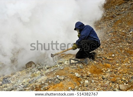 Geologist collecting minerals at volcano fumaroles. Kamchatka, Russia