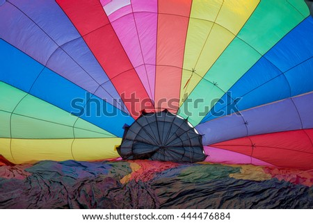 geometric abstract view inside a multocolored hot air balloon - stock photo