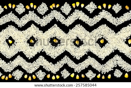 Geometric pattern backdrop of dry seed white rice and bright yellow corn isolated on black background. View close-up with space for text - stock photo