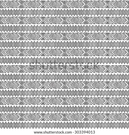 Geometric seamless pattern in ethnic style. Black and white graphics, diamonds, triangles, strips, painted by hand.