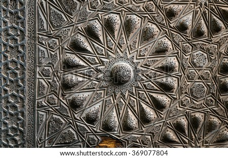 Geometrical brass decorations of an ancient historic door of an ancient mosque, Cairo, Egypt - stock photo