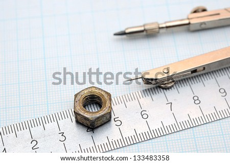 Geometry set with compass and ruler on graph paper - stock photo