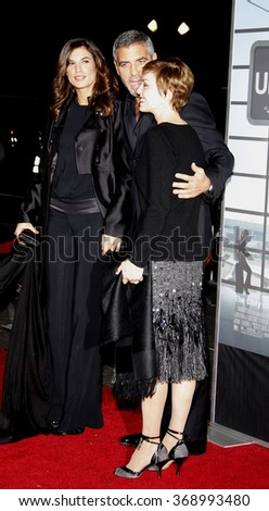"""George Clooney and Elisabetta Canalis at the Los Angeles Premiere of """"Up In The Air"""" held at the Mann Village Theater in Westwood, California, United States on November 30, 2009.   - stock photo"""