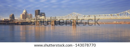 George Rogers Clark Memorial Bridge over the Ohio River with Louisville skyline in the background, KY - stock photo