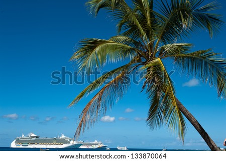 GEORGE TOWN, CAYMAN ISLANDS - NOVEMBER 3: Cruise ships anchored at the harbor of Grand Cayman for this popular stop of cruise lines on Nov 3, 2011 in George Town, Cayman Islands. - stock photo