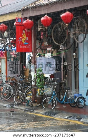 GEORGE TOWN, MALAYSIA - MAY 30: The colorful front of a shop with push bikes for hire in a street of George Town, Malaysia on the 30th May, 2014.