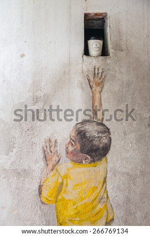 GEORGE TOWN,PENANG ,MALAYSIA- CIRCA March 26, 2015: Public street art Name Street Mural entitled Reaching Up on the wall by Ernest Zacharevic in Georgetown, Penang, Malaysia. - stock photo