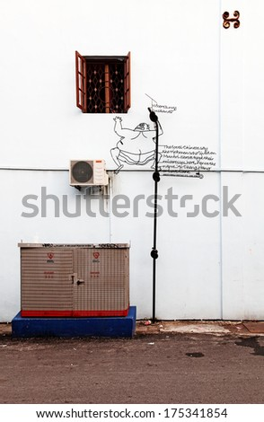 GEORGE TOWN, PENANG, MALAYSIA - JANUARY 5, 2014: Wire art of a philanderer climbing out of window created by Tang Mun Kian in Love Lane for the Marking George Town UNESCO World Heritage Site project. - stock photo