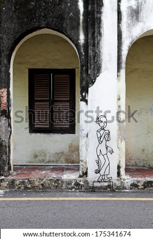 GEORGE TOWN, PENANG, MALAYSIA - JANUARY 5, 2014: Wire art of traditional Chinese woman created by Tang Mun Kian in Muntri Street for the Marking George Town UNESCO World Heritage Site project in 2009.