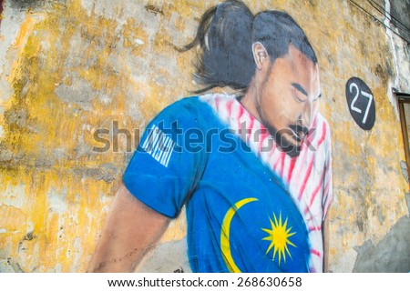 GEORGE TOWN,PENANG ,MALAYSIA- March 26, 2015: Public street art Name 27 Football player on the wall by Local Artist in Georgetown, Penang, Malaysia - stock photo