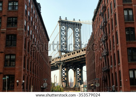 George Washington Bridge as seen from Street Level Between Low Rise Apartment Buildings with Traditional Architecture and View of New York City Skyscrapers in Background, New York, USA - stock photo