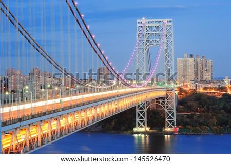 George Washington Bridge at dusk over Hudson River. - stock photo