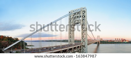 George Washington Bridge at sunset panorama over Hudson River.