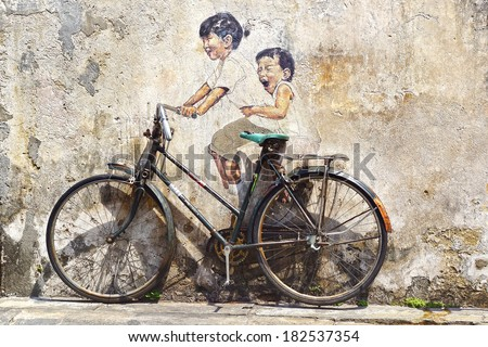"GEORGETOWN, MALAYSIA - JANUARY 19, 2014: ""Little Children on a Bicycle"" Mural by Lithuanian artist Ernest Zacharevic. Since then, many more wall paintings are one of the main tourist attractions.  - stock photo"