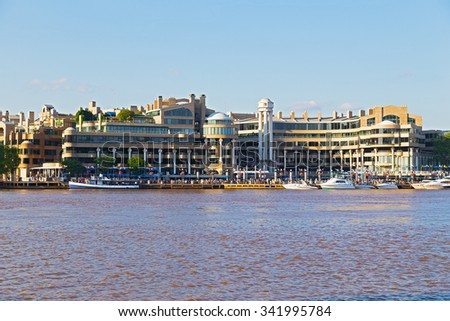 Georgetown Park waterfront at sunset in Washington DC, USA. A view on waterfront skyline from Theodore Roosevelt Island.  - stock photo