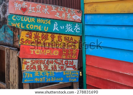 Georgetown, Penang, Malaysia - August 23, 2013: Colorful sign at Chew Jetty, village built on water by the Chinese Chew clan in the 19th century, as they could not get land in the UNESCO heritage zone
