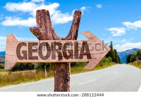 Georgia wooden sign with road background - stock photo