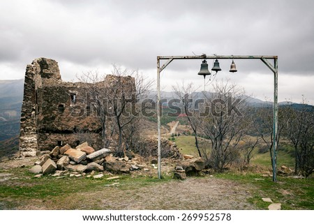 Georgian belfry by the ruins - stock photo
