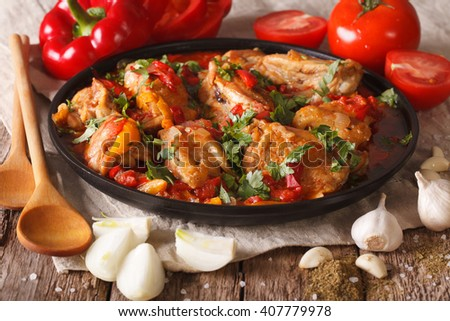 Georgian cuisine: Chakhokhbili chicken stew with vegetables on the table. close-up. Horizontal - stock photo