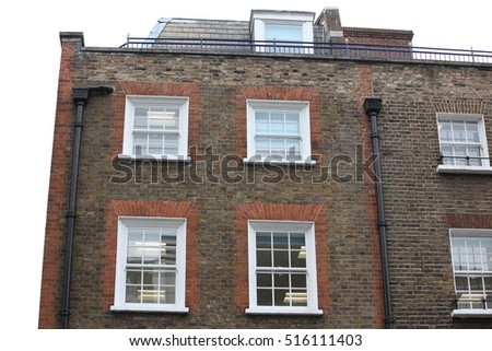 Georgian windows architecture on a wall house, London, UK