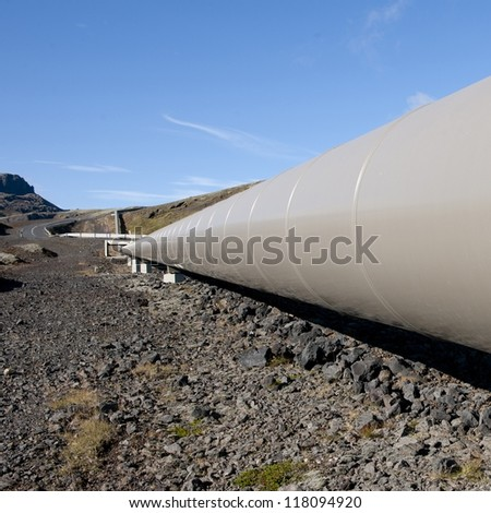 Geothermal heating pipe through Icelandic rural countryside