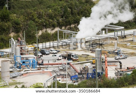 GEOTHERMAL POWER PRODUCTION PLANT NORTH ISLAND NEW ZEALAND = CIRCA 2014 - Steam and pipework at the Wairakei Geothermal Power Station at Taupo New Zealand