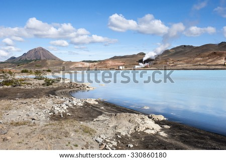 Geothermal power station and blue hot water lagoon, Northern Iceland - stock photo