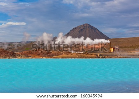 Geothermal Power Station and Bright Turquoise Lake in Iceland at Summer Sunny Day - stock photo