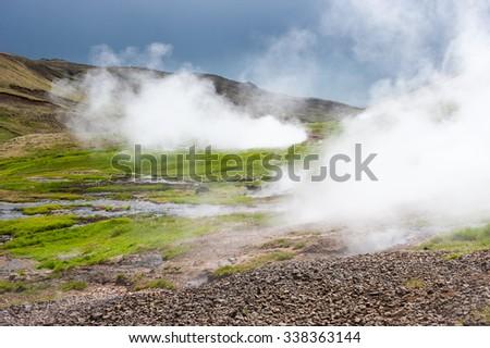 Geothermal valley with steam near Hveragerdi, thermal springs, Iceland - stock photo