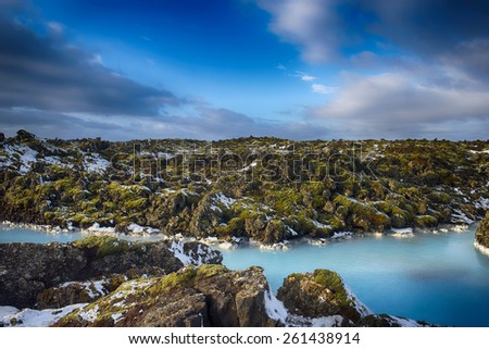 Geothermal water running through moss covered lava fields, Iceland. - stock photo