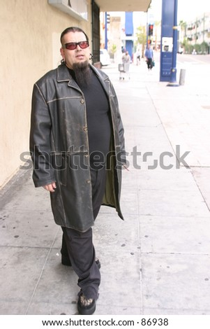 "Gerado Perez a member of the underground band ""Heavenly Trip To Hell"" walks down the street"