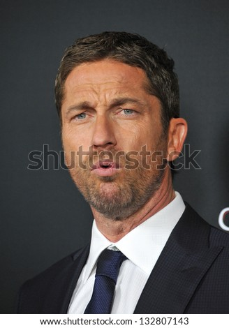 "Gerard Butler at the Los Angeles premiere of his movie ""Olympus Has Fallen"" at the Cinerama Dome, Hollywood. March 18, 2013  Los Angeles, CA Picture: Paul Smith"