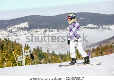 GERARDMER, FRANCE - FEB 17- Closeup on Snowborder during the annual winter school holiday on Feb 17, 2015 in Gerardmer, France