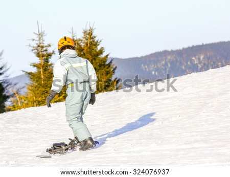 GERARDMER, FRANCE - FEB 20- Closeup on Snowborder during the annual winter school holiday on Feb 20, 2015 in Gerardmer, France