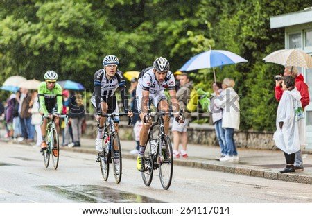 GERARDMER,FRANCE - JUL 12:Three cyclists, Florian Guillou,Albert Timmer and Maarten Wynants ride during the stage 8 of Le Tour de France on July 12, 2014 in Gerardmer - stock photo
