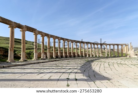 GERASA (JERASH), JORDAN- APRIL 05, 2014: Forum (Oval Plaza)  in Gerasa (Jerash), Jordan.  Forum is an asymmetric plaza at the beginning of the Colonnaded Street, built in the first century AD      - stock photo