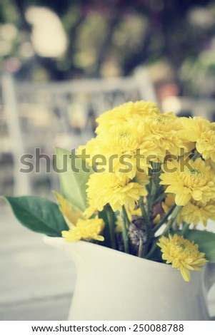 Gerbera flowers with vase - stock photo
