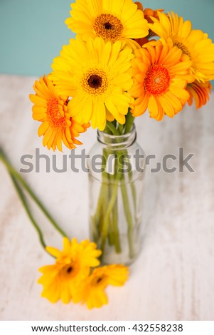 Gerbera in vase on a wooden table