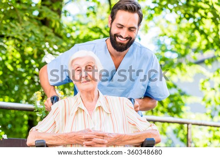 Geriatric nurse giving senior woman massage - stock photo