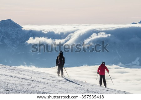 GERLITZEN, CARNIC ALPS, CARINTHIA, AUSTRIA - January 2, 2015: Skiers skiing downhill in high mountains.
