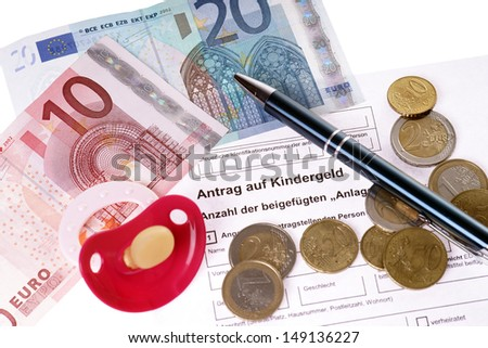 German application for child benefit with euro money and pacifier / child benefit