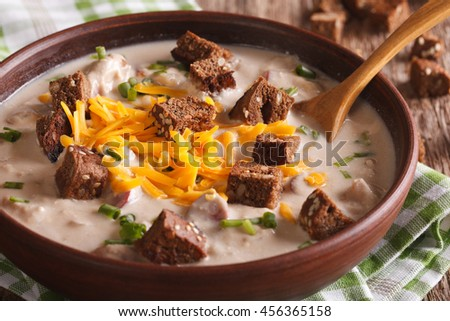 German beer soup with cheese and bacon close up in a bowl on the table. horizontal - stock photo