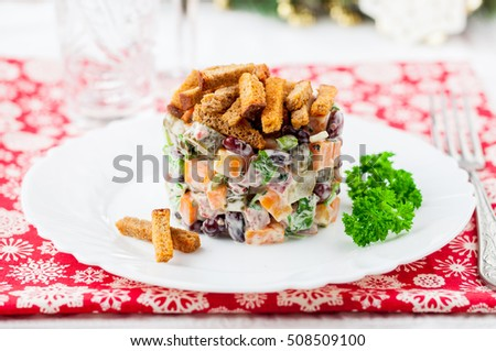 German Christmas Salad with Salami, Beans, Pickles and Rye Croutons