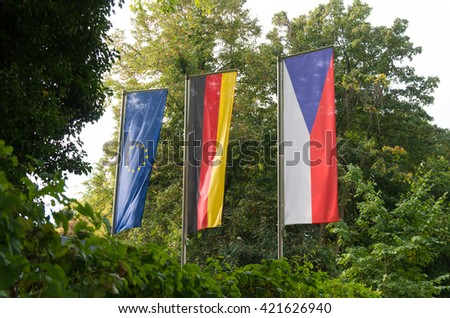 german, czech and european flag at the czech honorary consulate in dortmund, one of the six in germany  - stock photo