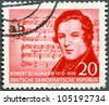 GERMAN DEMOCRATIC REPUBLIC - CIRCA 1956: A stamp printed in GDR shows Robert Schumann (1810-1856), (Music by Schubert), composer, centenary of the death, circa 1956 - stock photo
