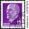 GERMAN DEMOCRATIC REPUBLIC - CIRCA 1961: A stamp printed in Germany shows the leader of East Germany from 1950 to 1971 Walter Ulbricht, circa 1961.  Vintage stamp isolated on black - stock photo
