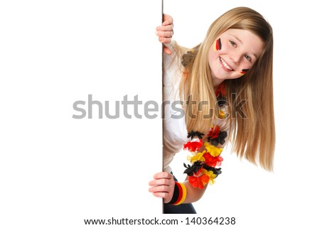 german fan holding a white placard with blank space for text - stock photo