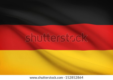 German flag blowing in the wind. Part of a series. - stock photo